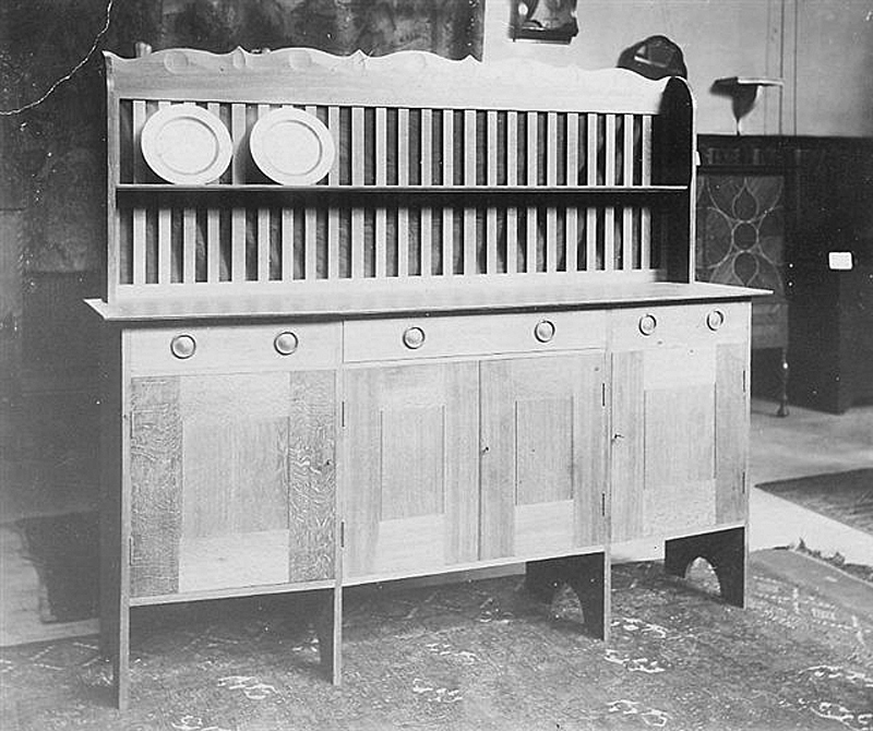 A dresser designed by Ernest Gimson for Kenton & Co.