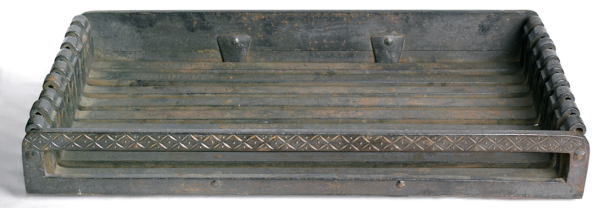 A fire basket designed by Gimson