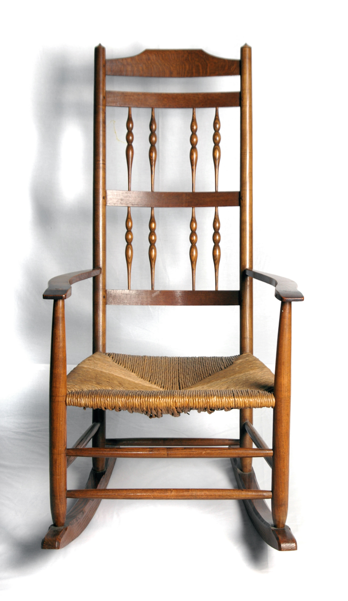 A rush-seated rocking chair