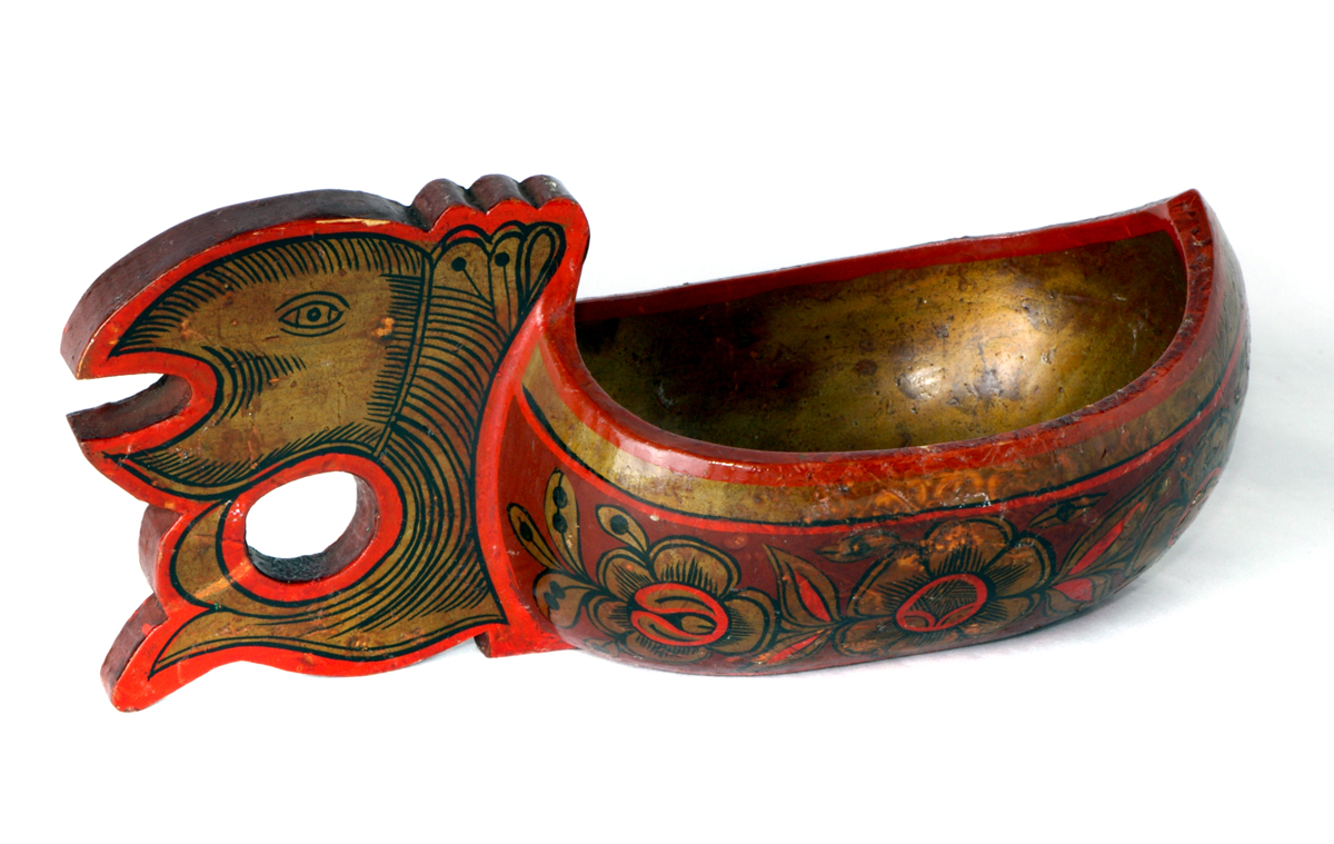 A painted Russian scoop from Leicester Museum's Dryad Craftwork Collection