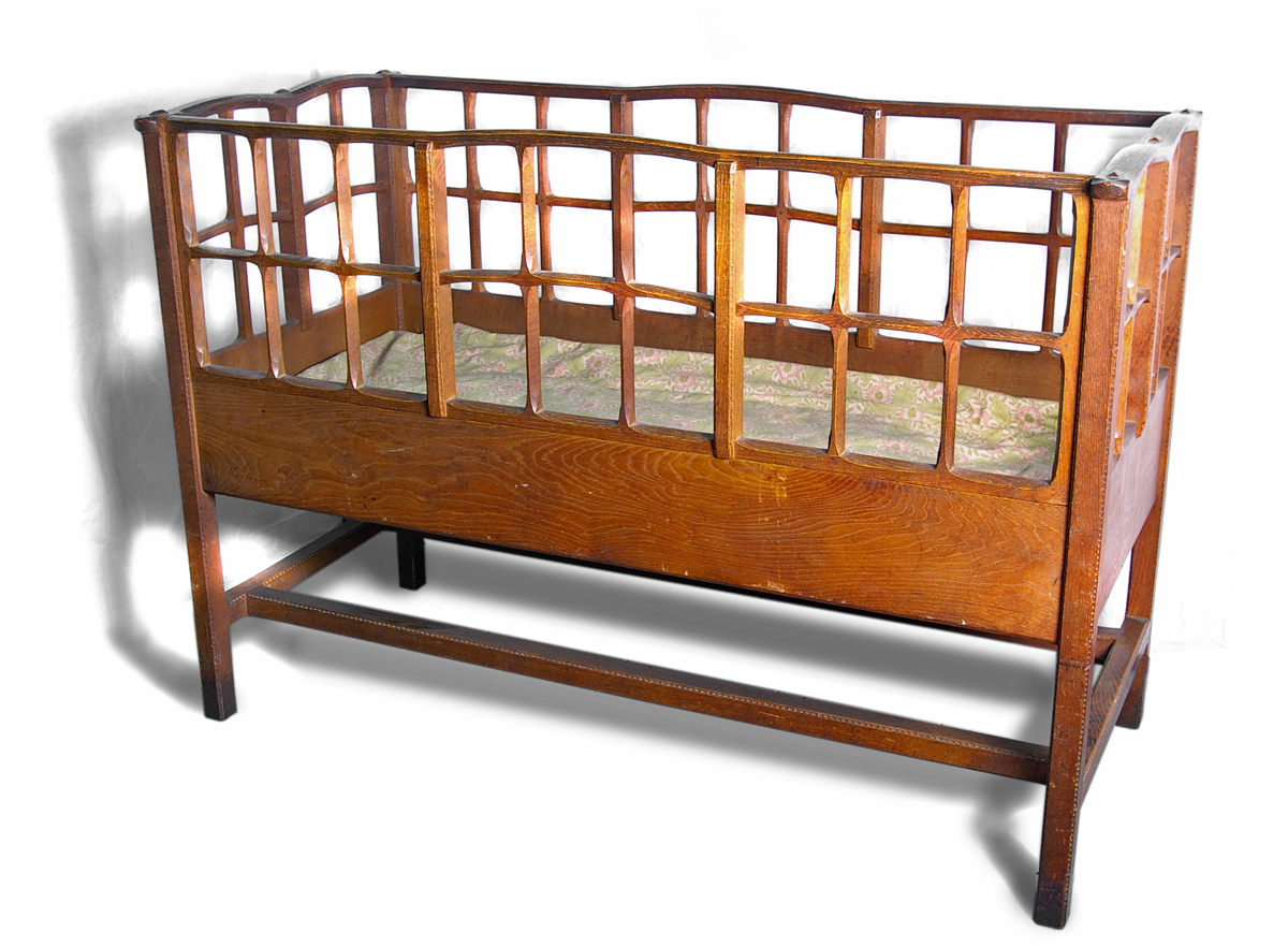 Oak cot designed by Gimson in the Leicester Museum Collection