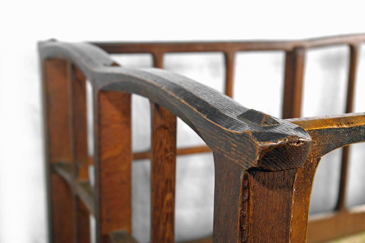 Detail of chamfering on the oak cot designed by Gimson