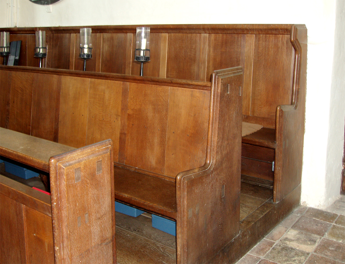 Pews in Ranworth church, Norfolk repaired by Gimson