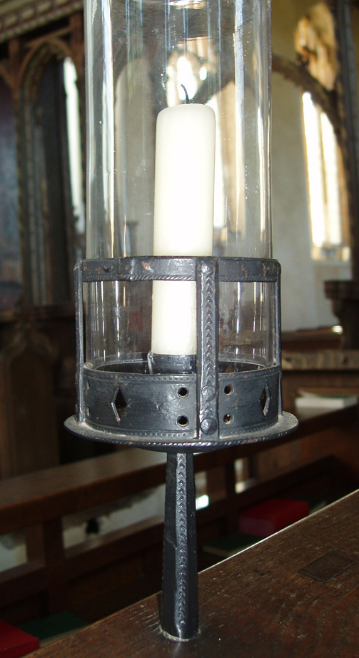 Steel candleholder in Ranworth church designed by Gimson