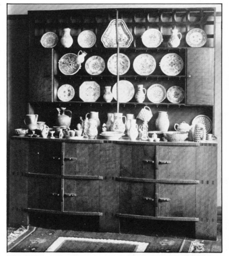A Gimson dresser displaying Wedgwood pottery in the Dryad showrooms, 1920s