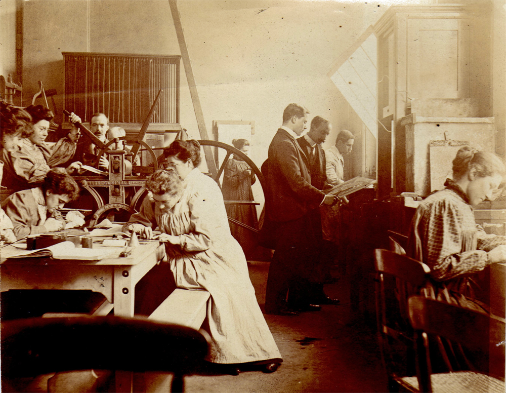 An early photograph c.1898, shows Mary on the far right, in what is believed to be Frank Short's etching class.
